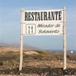 Cartel del restaurante junto a la antigua carretera